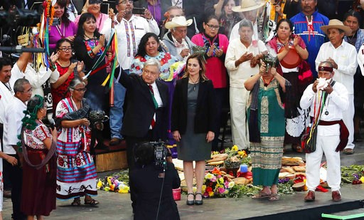 (AP Photo/Marco Ugarte). Mexico's new President Andres Manuel Lopez Obrador, center, participates in a traditional indigenous ceremony at the Zocalo, in Mexico City, Saturday, Dec. 1, 2018. Mexicans are getting more than just a new president Saturday. ...
