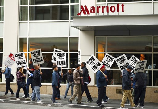 (AP Photo/Ben Margot, File). FILE - In this Oct. 4, 2018 file photo, hotel workers strike in front of a Marriott hotel in San Francisco. A contract agreement has been reached between Marriott and bargainers in San Francisco, possibly ending what has be...