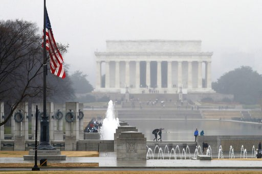 (AP Photo/Jacquelyn Martin). With the Lincoln Memorial in the background, an American flag at the WWII Memorial flies at half-staff, Saturday, Dec. 1, 2018, in Washington, after President Donald Trump directed that American flags be flown at half-staff...