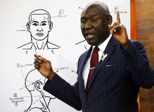 """(AP Photo/Jay Reeves). Attorney Ben Crump discusses the results of a forensic examination on Emantic """"EJ"""" Bradford Jr., who was fatally shot by police in a shopping mall on Thanksgiving day, during a news conference in Birmingham, Ala., on Monday, Dec...."""