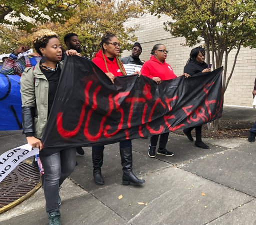 """(AP Photo/Kim Chandler). Protestors carry a sign reading """"Justice for E.J."""" during a protest at the Riverchase Galleria in Hoover, Ala., Saturday, Nov. 24, 2018. A police shot and killed 21-year-old Emantic Fitzgerald Bradford, Jr. of Hueytown while re..."""