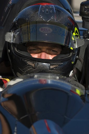 (AP Photo/Steve Nesius, File). FILE- In this March 19, 2010, file photo, Level 5 Motorsports driver Scott Tucker waits during a break in a practice session for the American Le Mans Series' 12 Hours of Sebring auto race in Sebring, Fla. A U.S. appeals c...
