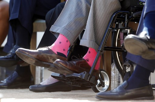 (AP Photo/Charles Dharapak, File). Former President George H.W. Bush wears pink socks at the dedication of the George W. Bush Presidential Library on the campus of Southern Methodist University in Dallas on April 25, 2013.