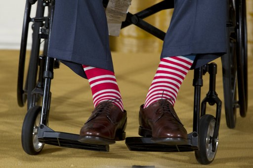 (AP Photo/Carolyn Kaster, File). Former President George H.W. Bush, in a pair of red and white socks, participates in a ceremony to present the 5,000th Daily Point of Light Award at the White House in Washington on July 15, 2013.