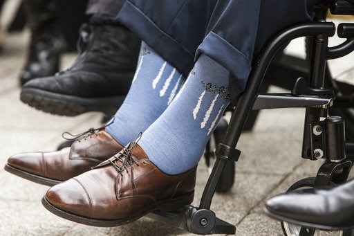 (Brett Coomer/Houston Chronicle via AP, File). Former President George H.W. Bush wears socks depicting military jets flying in formation during a Pearl Harbor remembrance ceremony at the George Bush Presidential Library in College Station, Texas on Dec...