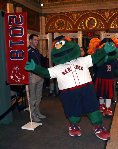 """(AP Photo/Charles Krupa). Boston Red Sox mascot Wally the Green Monster walks the red carpet prior to the premiere of """"The 2018 World Series: Damage Done,"""" documentary production that captures video moments of the Red Sox's march towards the 2018 World..."""