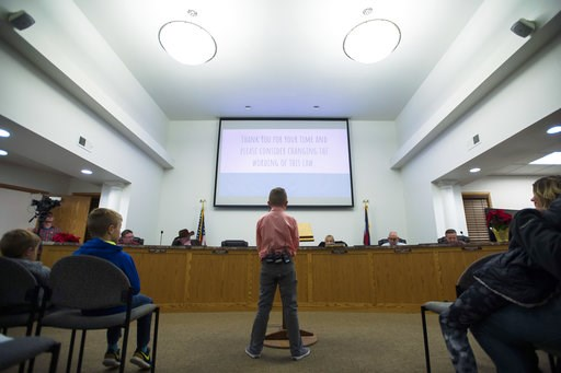 (Timothy Hurst/The Coloradoan via AP). Range View Elementary School third grader Dane Best presents his argument to town board trustees to change a law in Severance that bans snowball fights on Monday, Dec. 3, 2018, at the Town Hall in Severance, Colo....