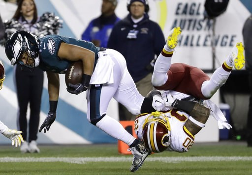 (AP Photo/Michael Perez). Philadelphia Eagles' Golden Tate (19) is tackled by Washington Redskins' Ha Ha Clinton-Dix (20) during the second half of an NFL football game, Monday, Dec. 3, 2018, in Philadelphia.