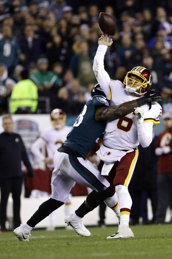 (AP Photo/Michael Perez). Washington Redskins' Mark Sanchez (6) is hit by Philadelphia Eagles' Nigel Bradham (53) during the first half of an NFL football game, Monday, Dec. 3, 2018, in Philadelphia.