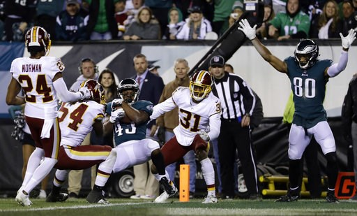 (AP Photo/Michael Perez). Philadelphia Eagles' Darren Sproles (43) scores a touchdown against Washington Redskins' Fabian Moreau (31), Mason Foster (54) and Josh Norman (24) during the first half of an NFL football game, Monday, Dec. 3, 2018, in Philad...