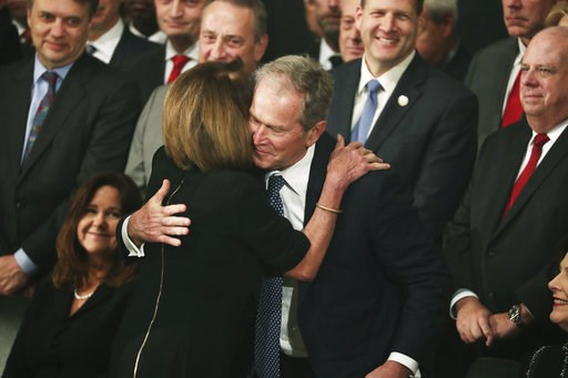 (Jonathan Ernst/Pool Photo via AP). Former President George W. Bush is embraced by Democratic House Leader Nancy Pelosi, D-Calif., during the arrival of the casket of former President George H.W. Bush into the Capitol in Washington, Monday, Dec. 3, 2018.