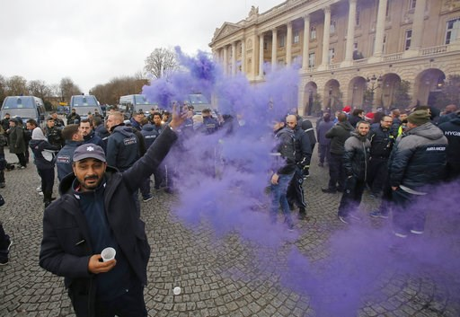 (AP Photo/Michel Euler). An ambulance worker holds a flare as he and his fellows block the Place de la Concorde in Paris, Monday, Dec. 3, 2018. Ambulance workers took to the streets and gathered close to the National Assembly in downtown Paris to compl...