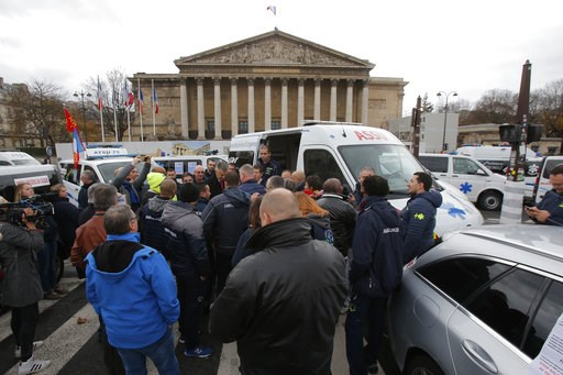 (AP Photo/Michel Euler). Ambulance workers block the bridge leading the National Assembly, background, Monday, Dec. 3, 2018 in Paris. Ambulance workers took to the streets and gathered close to the National Assembly in downtown Paris to complain about ...