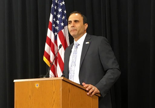 (AP Photo/Jacques Billeaud, File). FILE - In this July 5, 2018, file photo, Maricopa County Sheriff Paul Penzone talks at anews conference in Phoenix. Penzone, who two years ago defeated longtime Sheriff Joe Arpaio, is making progress in carrying out a...