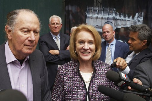 (AP Photo/Mark Lennihan, File). FILE - In this Oct. 2, 2018, file photo, Seattle Hockey Partners David Bonderman, left, and Seattle Mayor Jenny Durkan talk to the media as they leave a meeting at National Hockey League headquarters, in New York. The NH...