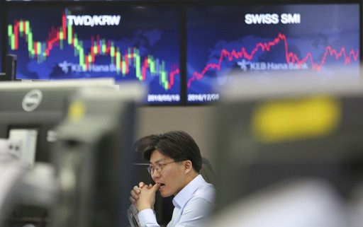 (AP Photo/Ahn Young-joon). A currency trader watches monitors at the foreign exchange dealing room of the KEB Hana Bank headquarters in Seoul, South Korea, Tuesday, Dec. 4, 2018. Asian shares were mostly lower Tuesday as investors wondered if a 90-day ...
