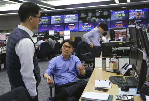 (AP Photo/Ahn Young-joon). Currency traders work at the foreign exchange dealing room of the KEB Hana Bank headquarters in Seoul, South Korea, Tuesday, Dec. 4, 2018. Asian shares were mostly lower Tuesday as investors wondered if a 90-day tariff truce ...