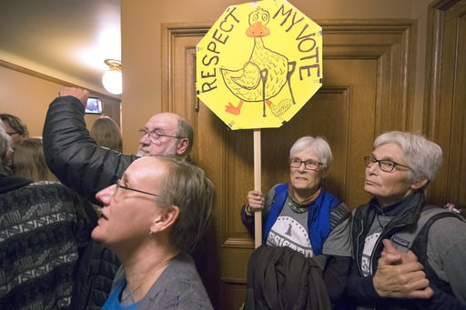 (Mark Hoffman/Milwaukee Journal-Sentinel via AP). People crowding a hallway vent their anger outside a lame duck session of the Joint Finance Committee Monday, December 3, 2018 at the Capitol in Madison, Wis. Wisconsin Republicans planned to forge ahea...