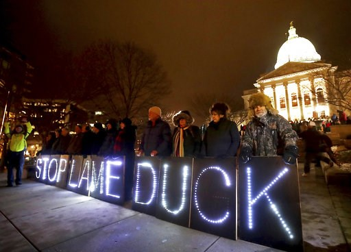 "(John Hart/Wisconsin State Journal via AP). Opponents of an extraordinary session bill submitted by Wisconsin Republican legislators hold ""Stop Lame Duck"" signs at a rally outside the Wisconsin state Capitol in Madison, Wis., Monday, Dec. 3, 2018."
