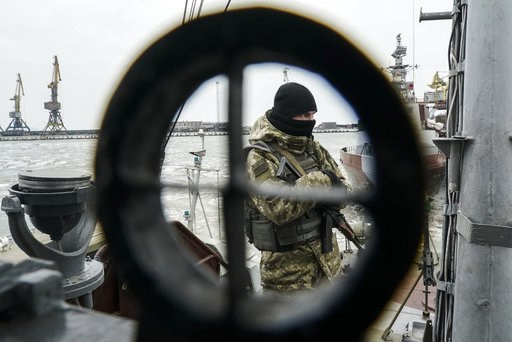 (AP Photo/Evgeniy Maloletka). A Ukrainian serviceman stands on board a coast guard ship in the Sea of Azov port of Mariupol, eastern Ukraine, Monday, Dec. 3, 2018. The Ukrainian military has been on increased readiness as part of martial law introduced...
