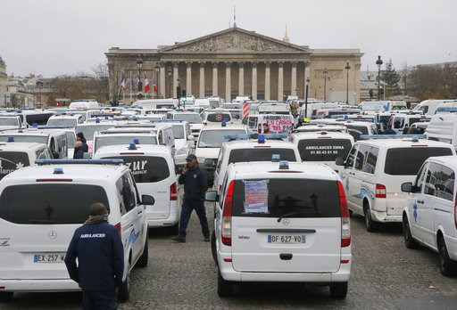 (AP Photo/Michel Euler). Ambulance workers block the bridge leading the National Assembly, background, in Paris, Monday, Dec. 3, 2018. Ambulance workers took to the streets and gathered close to the National Assembly in downtown Paris to complain about...
