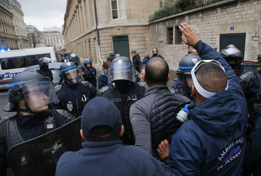 (AP Photo/Michel Euler). Ambulance workers face riot police officers outside the National Assembly in Paris, Monday, Dec. 3, 2018. Ambulance workers took to the streets and gathered close to the National Assembly in downtown Paris to complain about cha...