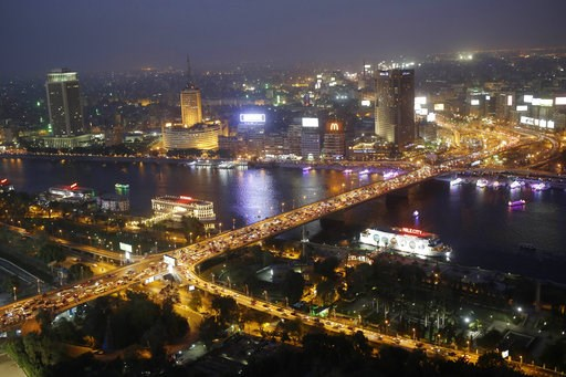 (AP Photo/Hassan Ammar, File). FILE - In this Tuesday, May 5, 2015 file photo, rush hour traffic fills the 6 October bridge over the Nile River in Cairo, Egypt. Uber is launching a new minibus service on Tuesday, Dec. 4, 2018, in traffic-mad Cairo, Egy...