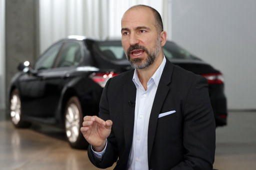 (AP Photo/Richard Drew, File). FILE - In this Sept. 5, 2018, file, photo, Uber CEO Dara Khosrowshahi speaks during an interview after the company unveiled new features in New York. Uber is launching a new minibus service on Tuesday, Dec. 4, 2018, in tr...