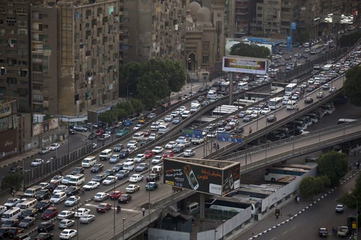 (AP Photo/Hassan Ammar, File). FILE - In this Oct. 7, 2013, file, photo, cars are bumper to bumper on a bridge in Cairo, Egypt. Uber is launching a new minibus service on Tuesday, Dec. 4, 2018, in traffic-mad Cairo, Egypt's capital and the ride-sharing...