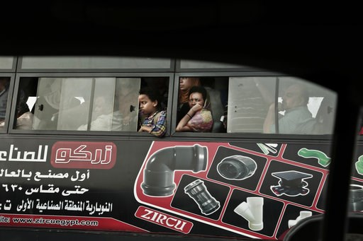 (AP Photo/Nariman El-Mofty, File). FILE - In this Tuesday, Oct. 18, 2016, file, photo, commuters ride a public bus as they wait in traffic, in Cairo, Egypt. Uber is launching a new minibus service on Tuesday, Dec. 4, 2018, in traffic-mad Cairo, Egypt's...