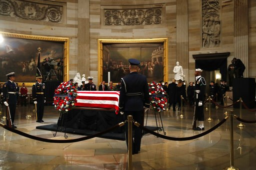 (AP Photo/Jacquelyn Martin). President Donald Trump and first lady Melania Trump leave the Rotunda of the U.S. Capitol after paying their respects to former President George H. W. Bush, Monday, Dec. 3, 2018, in Washington.