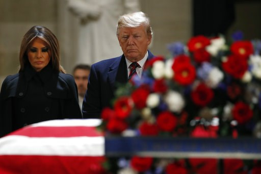 (AP Photo/Jacquelyn Martin). President Donald Trump and first lady Melania Trump pay their respects to former President George H. W. Bush, as he lies in state in the Rotunda of the U.S. Capitol, Monday, Dec. 3, 2018, in Washington.