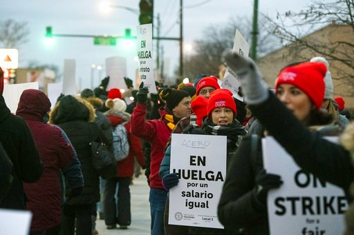 (Tyler LaRiviere/Chicago Sun-Times via AP). Educators with Acero charter schools strike outside Veterans Memorial Charter School Campus, Tuesday, Dec. 4, 2018, in Chicago. Hundreds of teachers have gone on strike at the Chicago charter school network, ...