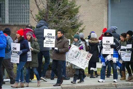 (Tyler LaRiviere/Chicago Sun-Times via AP). Educators with Acero charter schools strike outside the Veterans Memorial Charter School Campus, Tuesday, Dec. 4, 2018, in Chicago. Hundreds of teachers have gone on strike at the Chicago charter school netwo...