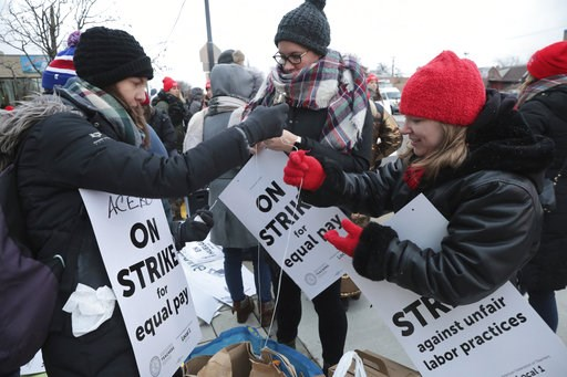 (Antonio Perez/ Chicago Tribune via AP). From left to right, Kathryn Schoedel, a teacher at Ziumbo Elementary School, Lindsay Anderson, a teacher at Torres Elementary school and Vanessa Cerf-Nikolakakis, a teacher at Torres Elementary School with their...