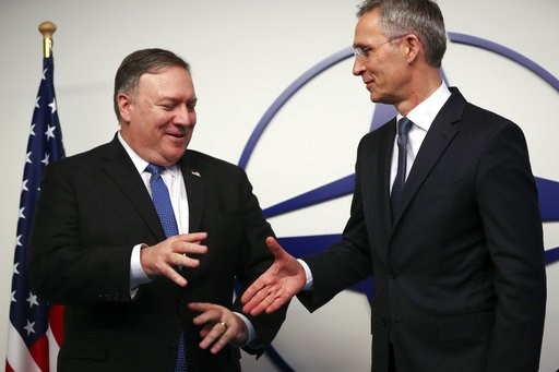 (AP Photo/Francisco Seco, Pool). U.S. Secretary of State Mike Pompeo, left, shakes hands with NATO Secretary General Jens Stoltenberg prior to a meeting at NATO headquarters in Brussels, Tuesday, Dec. 4, 2018. U.S. Secretary of State Mike Pompeo on Tue...