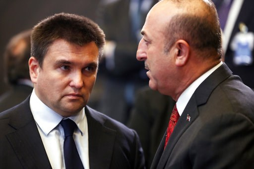 (AP Photo/Francisco Seco). Turkish Foreign Minister Mevlut Cavusoglu, right, speaks with Ukraine's Foreign Minister Pavlo Klimkin during a round table meeting of the North Atlantic Council with Georgia and Ukraine at NATO headquarters in Brussels, Tues...