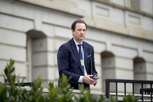 (AP Photo/Andrew Harnik). BMW Vice President for Government and External Affairs Bryan Jacobs arrives for a meeting with Trump Administration officials at the White House complex in Washington, Tuesday, Dec. 4, 2018.