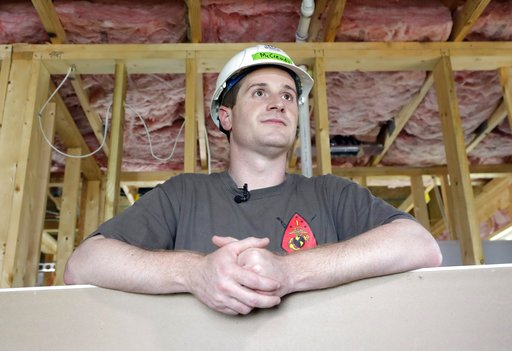 (AP Photo/Chuck Burton, File). FILE - In this Sept. 26, 2018, file photo, Democratic congressional candidate Dan McCready leans against wallboard as he pauses during a Habitat For Humanity building event in Charlotte, N.C. The nation's last unresolved ...