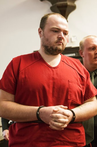 (Robert McGraw//The Chillicothe Gazette via AP, Pool). George Wagner IV walks into the courtroom at the Pike County Courthouse for his arraignment on Wednesday, Nov. 28, 2018 in Waverly, Ohio.  Wagner, his parents and his brother are charged in the 201...