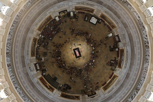 (Pool photo by Morry Gash via AP). Former President George H. W. Bush lies in state in the U.S. Capitol Rotunda Tuesday, Dec. 4, 2018, in Washington.
