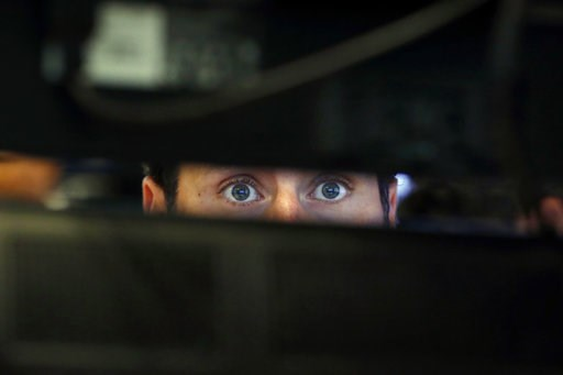 (AP Photo/Richard Drew, File). FILE- In this Nov. 28, 2018, file photo specialist Michael Pistillo watches the screens at his post on the floor of the New York Stock Exchange. One of the most reliable warning signals for recession just got a bit bright...