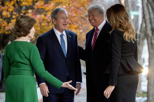 (AP Photo/Andrew Harnik). President Donald Trump and first lady Melania Trump are greeted by former President George Bush and former first lady Laura Bush outside the Blair House across the street from the White House in Washington, Tuesday, Dec. 4, 20...