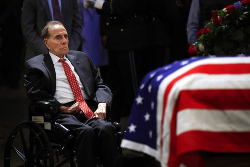 (AP Photo/Manuel Balce Ceneta). Former Sen. Bob Dole pays his last respects to former President George H.W. Bush as he lies in state at the U.S. Capitol in Washington, Tuesday, Dec. 4, 2018.