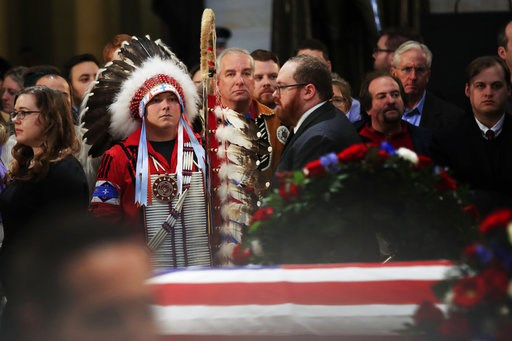 (AP Photo/Manuel Balce Ceneta). Native Americans Donald Woody, left, and Warren Stade of the Shakopee Mdewakanton Sioux Community tribe in Prior Lake, Minn., pay their last respects to former President George H.W. Bush as he lies in state at the U.S. C...