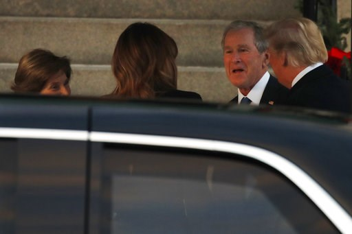 (AP Photo/Jacquelyn Martin). President Donald Trump, right, and first lady Melania Trump, arrive at Blair House and are greeted by former President George W. Bush and former first lady Laura Bush, Tuesday, Dec. 4, 2018, in Washington.