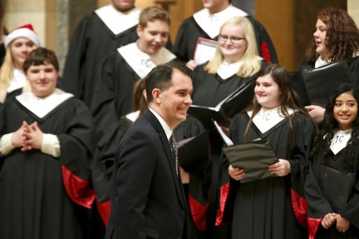 (Steve Apps/Wisconsin State Journal via AP). Wisconsin Gov. Scott Walker arrives for the lighting of the state Christmas Tree in the Capitol Rotunda, Tuesday, Dec. 4, 2018 at the Capitol in Madison, Wis. The Senate and Assembly are set to send dozens o...