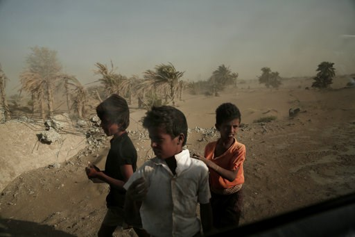 (AP Photo/Nariman El-Mofty, File). FILE - In this Feb. 12, 2018, file, photo, homeless children stand on the road from Khoukha to Taiz in Yemen. Envoys from Yemen's warring parties are headed to Sweden for another round of peace talks to stop the three...