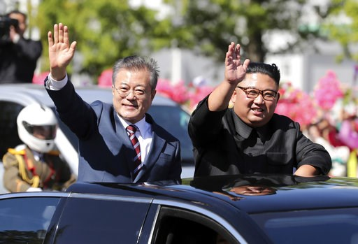 (Pyongyang Press Corps Pool via AP, File). FILE - In this Sept. 18, 2018, file photo, South Korean President Moon Jae-in, left, and North Korean leader Kim Jong Un ride in a car during a parade through a street in Pyongyang, North Korea. Day after day,...