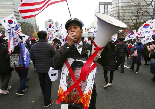 (AP Photo/Ahn Young-joon, File). FILE - In this Nov. 17, 2018, file photo, a protester with a defaced portrait of North Korean leader Kim Jong Un shouts during a rally to denounce policies of South Korean President Moon Jae-in on North Korea in Seoul, ...